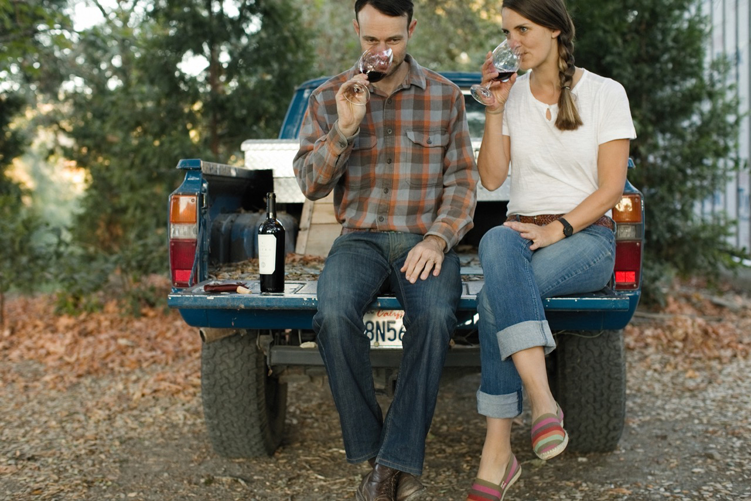 couple drinking wine, back of truck